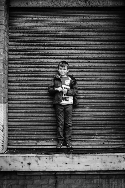 Using metal shutter of a loading bay as an urban portrait background